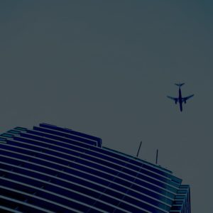 Building and Airplane crossing the skyline
